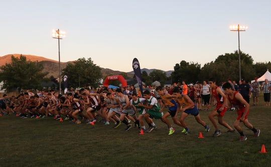 High school runners compete in the Bonanza Casino Nevada Twilight Classic at Mira Loma Park in Reno on Friday night