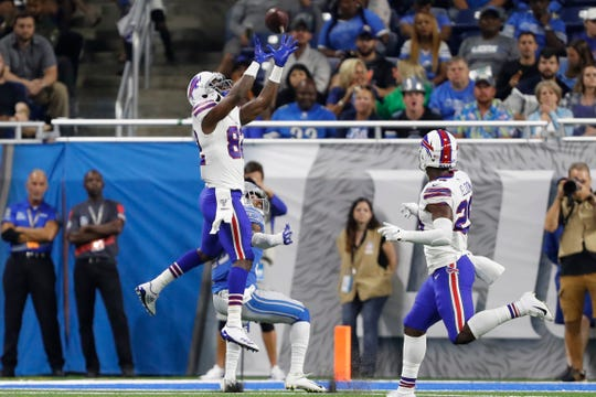 Duke Williams (82) makes a touchdown catch over Detroit Lions defensive back Andre Chachere (36) during the third quarter at Ford Field.