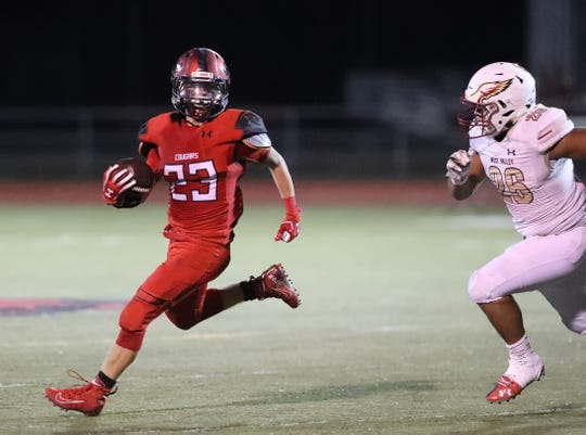 Foothill's Bryce Henderson, left, had two touchdowns in the first half and finished with 21 carries and 89 yards against West Valley on Friday, Aug. 30, 2019.