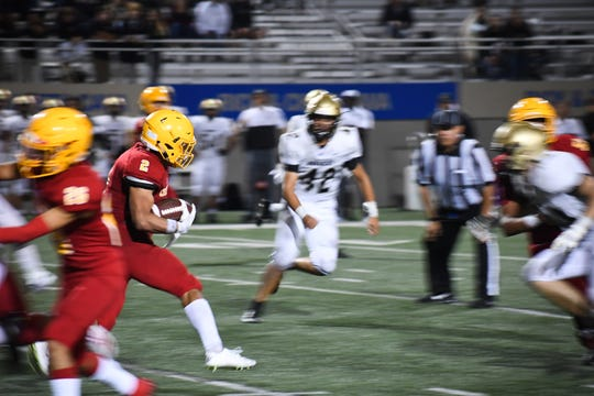 Palma running back Anthony Villegas (2) cuts back in the first half against Archbishop Mitty. Aug. 30, 2019.