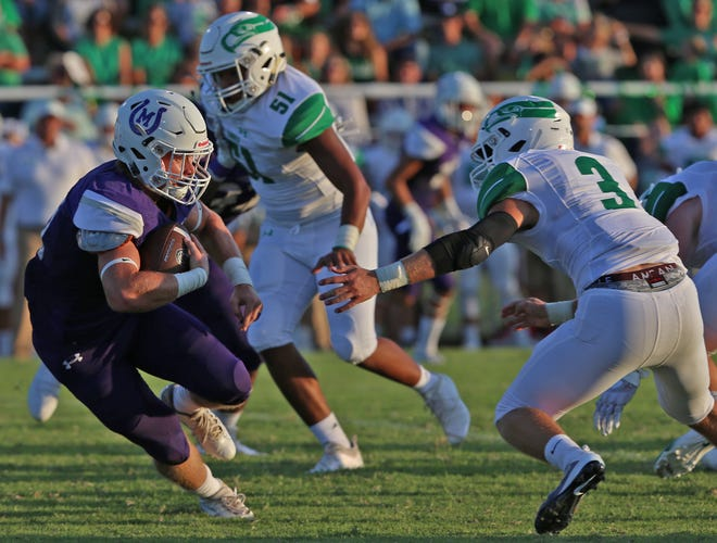 Klay Klaerner, left, tries to dodge a Wall defender during the first game of the season Thursday, August 29, 2019.