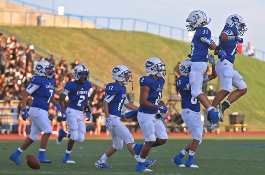 Players for Lake View celebrate after a play during the first game of the season Friday, August 30, 2019.