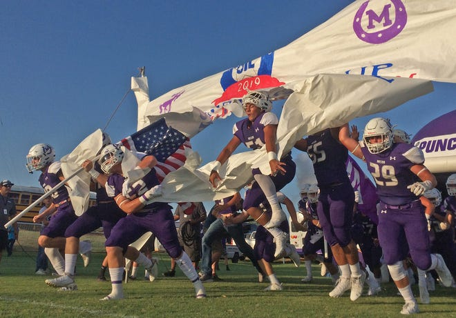 The team for Mason takes to the field prior to kickoff of the season opener against Wall on Thursday, August 29, 2019.