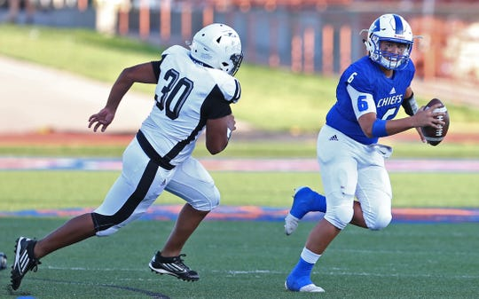 Albert Rodriguez, right, scrambles out of the pocket for Lake View during the season opener Friday, August 30, 2019.