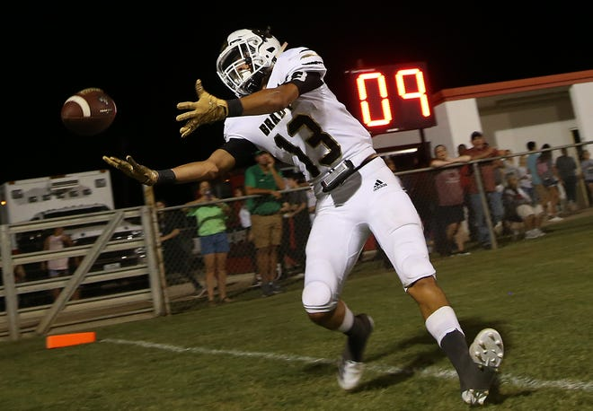 Caleb Galindo tries to make a catch in the end zone for Brady during the first game of the season against Ballinger on Friday, August 30, 2019.