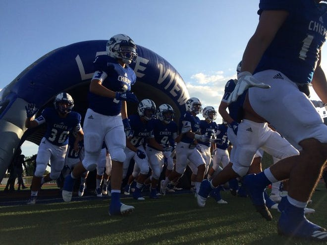 The Lake View Chiefs run onto the field at San Angelo Stadium before their season opener against Lamesa on Friday, Aug. 30, 2019.