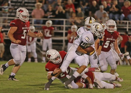 Caleb Galindo, right, breaks a tackle for Brady during the season opener on the road against Ballinger on Friday, August 30, 2019.