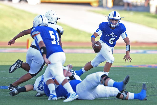 Albert Rodriguez, right, scrambles under pressure for Lake View during the season opener against Lamesa on Friday, August 30, 2019.