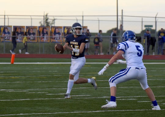 Tea Area's Austin Lake looks to pass against Canton on Friday, Aug. 30, in Tea.