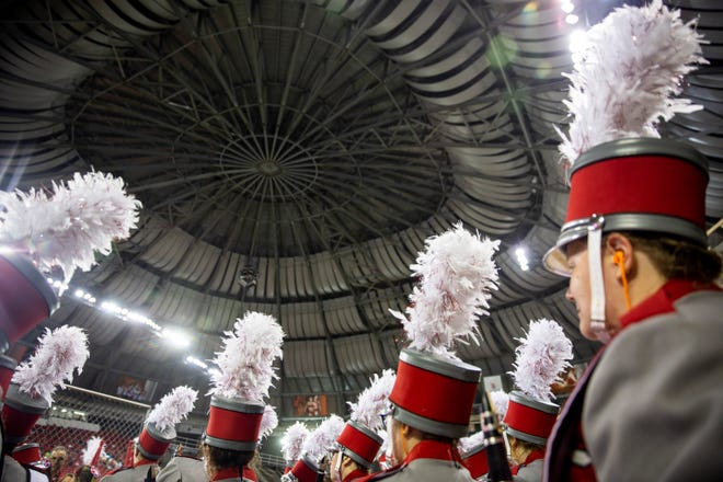 USD marching band members prepare to take the field during USD's season opener against Montana at the DakotaDome on Saturday, Aug. 31.