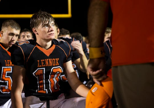 Lennox High School wide receiver Eli Olson (10) meets with the team after their first home game on Friday, Aug. 30.  Lennox lost the game with a score of 7-6.