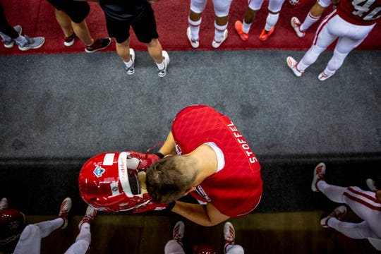 USD tight end Nathan Stoffel (45) puts his helmet on before heading out onto the field during USD's season opener at the DakotaDome on Saturday, Aug. 31.