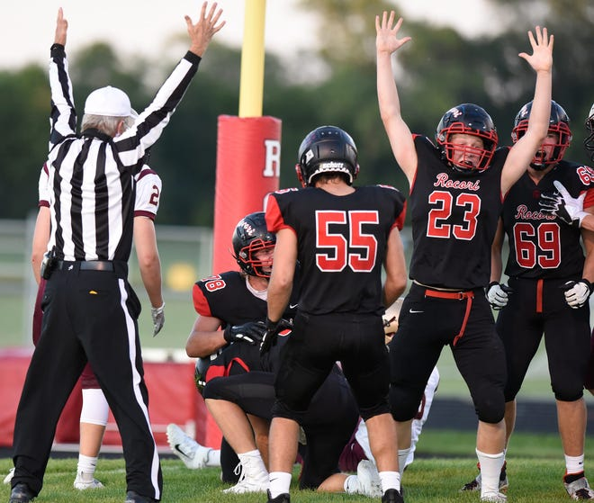 ROCORI players celebrate a touchdown during their home opener Thursday in Cold Spring.