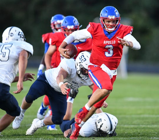 Apollo quarterback Logan Johnson rushes with the ball during the Friday, Aug. 30, 2019, game in St. Cloud.