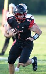 Quarterback Jack Steil evades Fergus Falls defenders Thursday, Aug. 29, 2019, at ROCORI High School.