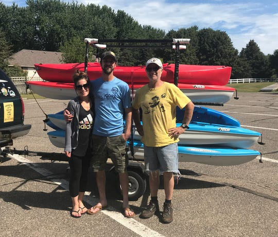 Eli Anderson (from left), Adam Studer and Eddie Cheeseman  pose for a photo at a boat ramp near Sauk Rapids Saturday afternoon. Studer and Anderson were preparing to go kayaking through Granite City Kayak and Tube.