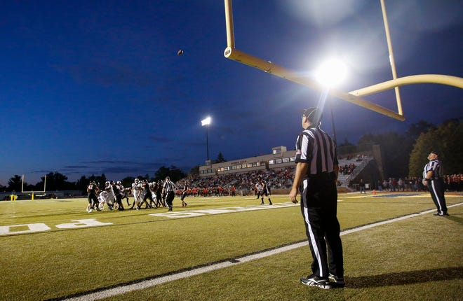 Referees watch the ball on an extra point attempt during a high school football game between SPASH and Fond du Lac on Aug. 30, 2019, at Goerke Field in Stevens Point.