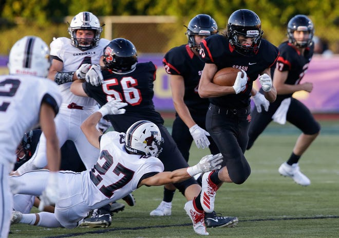 SPASH's Colton Engle (83) runs the ball against Fond du Lac during a prep football game Aug. 30, 2019, at Goerke Field in Stevens Point.