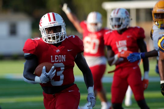 Leon Lions running back Steven Bivins (3) runs towards the end zone. The Leon Lions and Rickards Raiders played under the Friday night lights of Gene Cox Stadium Aug. 30, 2019.