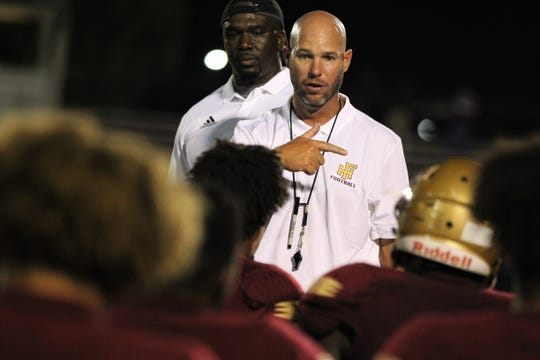 Florida High head coach Jarrod Hickman talks to his team after they beat Taylor County 52-12 on Friday, Aug. 30, 2019.