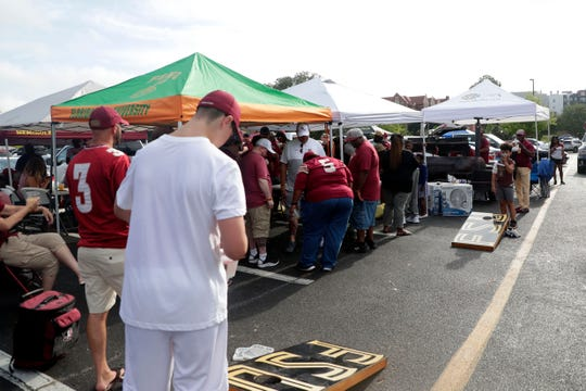 A large tailgate in a parking lot before the Seminoles game against the Boise State Broncos.
