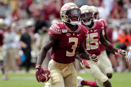Florida State Seminoles running back Cam Akers (3) smiles and cheers as he scores the first touchdown for the Seminoles of the season. The Florida State Seminoles host the Boise State Broncos for their first game of the season. The game was previously scheduled to be played in Jacksonville, Fla. but was moved to Tallahassee due to the threat of Hurricane Dorian.