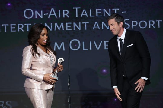 FAMU alum Pam Oliver stands alongside Fox Sports colleague Kevin Burkhardt during the 43rd Annual Gracie Awards at the Beverly Wilshire Four Seasons Hotel on May 22, 2018 in Beverly Hills, California. Oliver was honored for Best On-Air Talent.