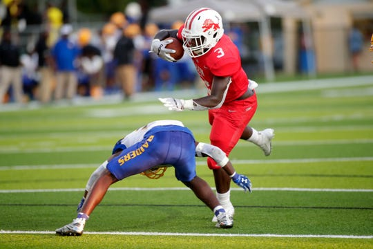 Leon Lions running back Steven Bivins (3) leaps over his defender. The Leon Lions and Rickards Raiders played under the Friday night lights of Gene Cox Stadium Aug. 30, 2019.