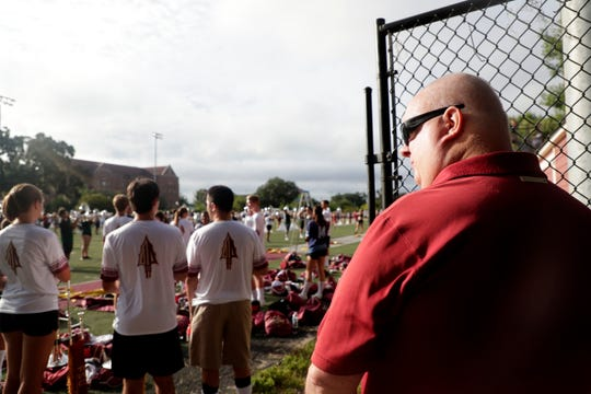 Paul Fields enjoys listening as the Marching Chiefs practice for their halftime performance.