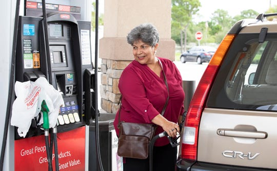 """RaceTrac has never failed me,"" said Claudia Alzate-Zapata, of Port St. Lucie, who fills up her mother's car with gas in preparation for Hurricane Dorian on Saturday, Aug. 31, 2019, at the RaceTrac at 8630 S. U.S. 1 in Port St. Lucie. The station was out of diesel, but had regular gas. Some stations were out of gas, but expecting deliveries throughout the day. Lines weren't as long at several gas stations along the US 1 corridor as many customers filled up earlier in the week."