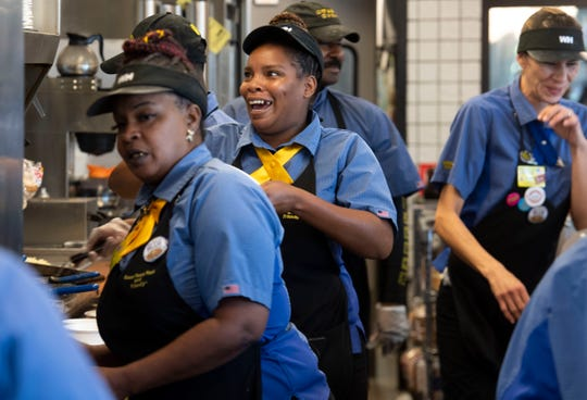 Nicole Williams, Waffle House #443 salesperson, is in good spirits as she continues to work Saturday, Aug. 31, 2019, in Fort Pierce. As the Category 4 hurricane approached Florida, regular customers and folks fleeing north stopped by for food at the chain that is notorious for opening back up soon after a hurricane passes.