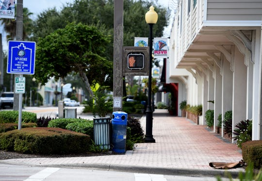 Downtown Vero Beach along 14th Avenue is quiet, with many businesses boarded up and closed Saturday, Aug. 31, 2019, in preparation of Hurricane Dorian.