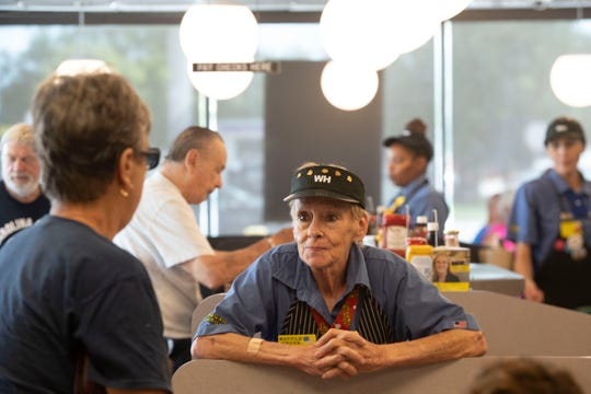 Donna Michaud, Waffle House #443 salesperson, interacts with customers ahead of Hurricane Dorian on Saturday, Aug. 31, 2019, in Fort Pierce, Florida. As the hurricane approached Florida, regular customers and those fleeing north stopped by for food at the chain that is notorious for opening back up soon after a hurricane passes.