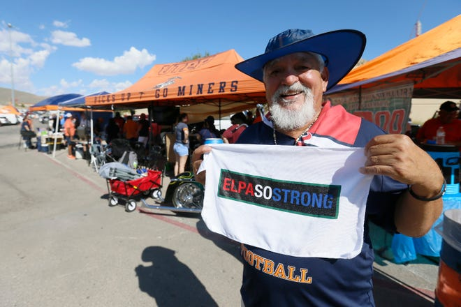 """UTEP fan Harvey Sanchez holds up his """"El Paso Strong"""" towel while tailgating before the game against Houston Baptist on Saturday, Aug. 31, 2019, in the season opener at Sun Bowl Stadium in El Paso."""
