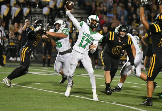 Thousand Oaks quarterback Miles Briers throws a pass in Friday's game at rival Newbury Park.