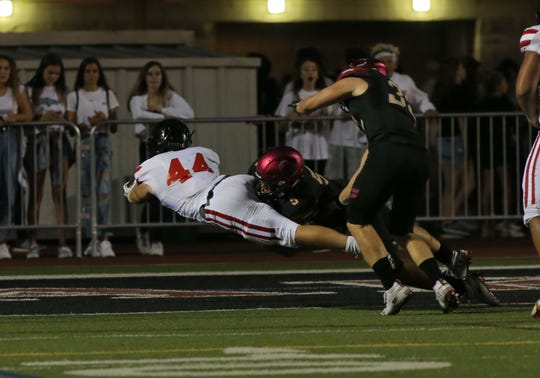 Grace Brethren's Josh Henderson dives in the end zone in the second quarter of the Lancers' 54-28 victory over host Oaks Christian on Friday night.
