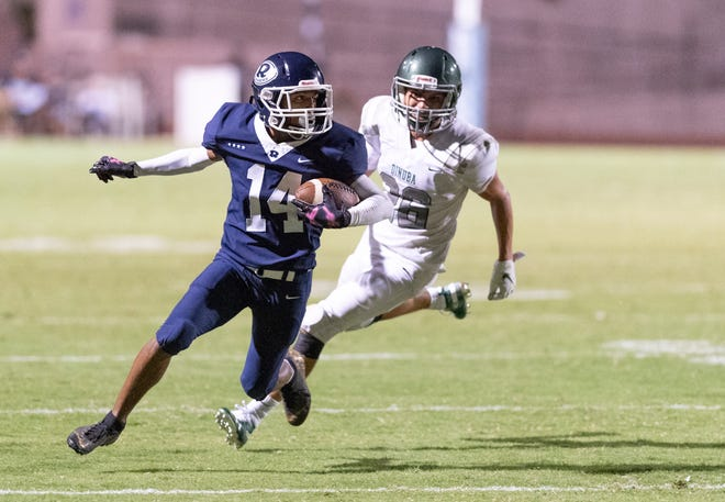 Redwood's Malachi Aguilar runs against Dinuba at Mineral King Bowl in a non-league football game on Friday, August 30, 2019.