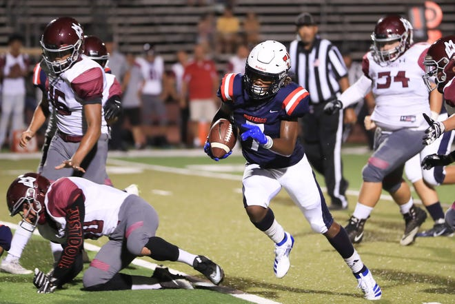 Tulare Western's Tairyn Johnson (7) rushes for a TD against Mt Whitney in a non-league High School Football game at Bob Mathias Stadium  in Tulare on Friday, August 30, 2019.