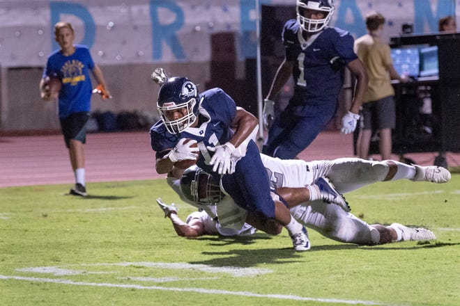 Redwood's James Richardson gets close to a touchdown against Dinuba at Mineral King Bowl in a non-league football game on Friday, August 30, 2019.