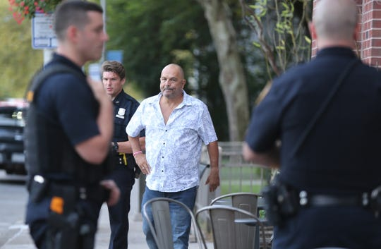 Isaac Hershko, owner of thge Brickhouse, talks with Orangetown Police Officers outside the restaurant in Nyack on Saturday, August 31, 2019.