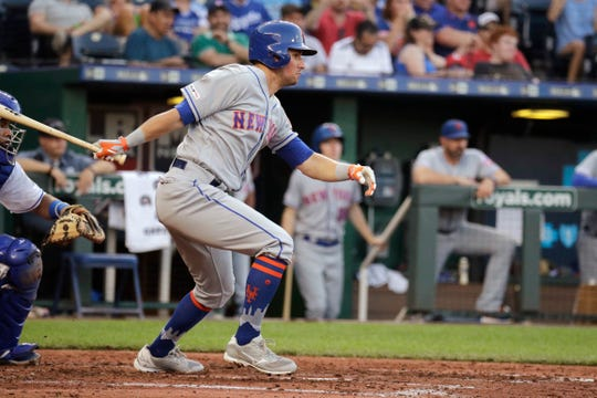 New York Mets' Joe Panik watches his RBI single during the fifth inning of a baseball game against the Kansas City Royals Saturday, Aug. 17, 2019, in Kansas City, Mo. (AP Photo/Charlie Riedel)