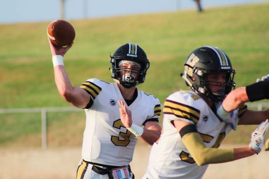 Henrietta's Jonah Lyde fires off a pass against Windthorst. Lyde threw for 125 yards and a touchdown.
