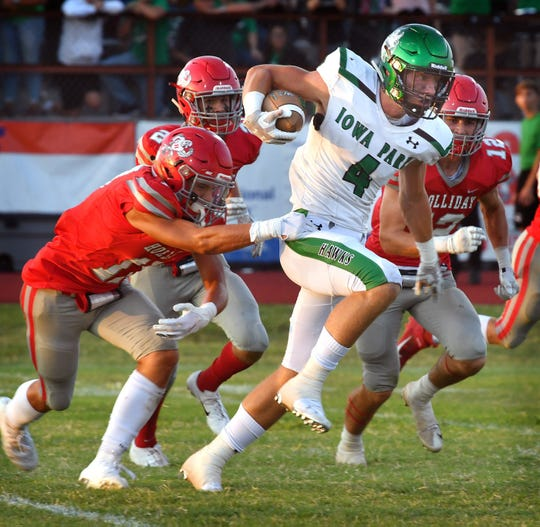 Iowa Park runningback Cirby Coheley (4) picks up good yardage during first quarter action against the Holliday Eagles Friday night in Holliday.