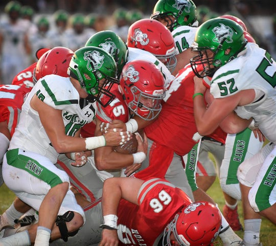 Holliday Eagles quarterback Kase Patterson (15)  powers forward into the end zone against the Iowa Park Hawks Friday night.