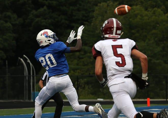 Zanesville's Jamal Wiggins pulls in a touchdown pass against Newark.