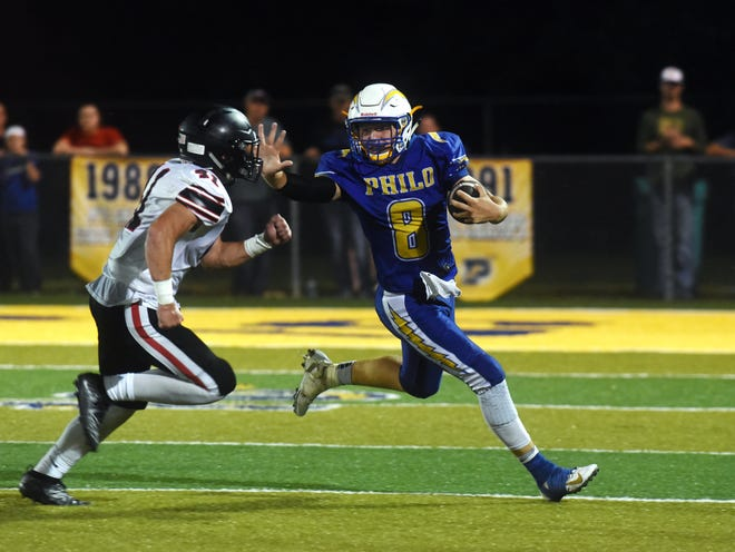 Philo's Hunter Adolph stiff-arms Chase Maynard during a 24-16 loss to visiting Plain City Jonathan Alder in Week 1. The Electrics have bounced back with two wins and host John Glenn in a key league clash this Friday.