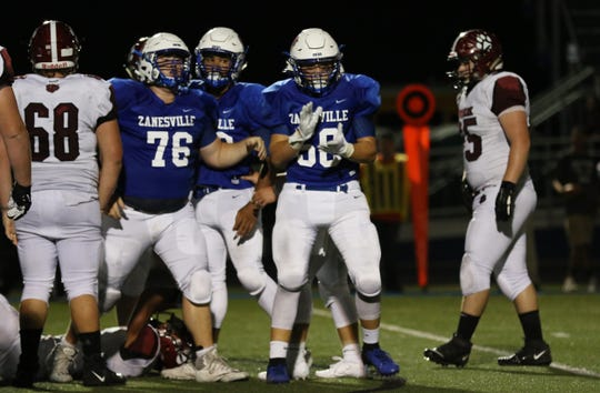 Zanesville celebrates a sack against Newark.