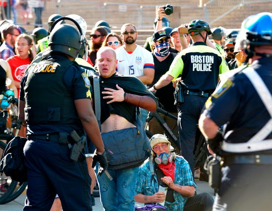 "Protesters are overcome after police used pepper spray on anti-parade demonstrators during the ""Straight Pride"" parade in Boston, on August 31, 2019. - ""Straight Pride"" advocates who support President Donald Trump and counter-demonstrators who consider them homophobic extremists staged dueling rallies in Boston on Saturday. (Photo by Joseph PREZIOSO / AFP)JOSEPH PREZIOSO/AFP/Getty Images ORG XMIT: Conservat ORIG FILE ID: AFP_1JX2FW"