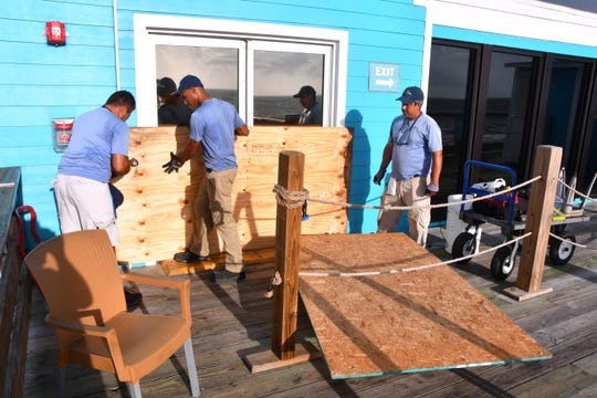 The workers were boarding up the doors on the Cocoa Beach Pier Saturday morning. Brevard County residents were busy Saturday preparing for the arrival of Hurricane Dorian, its path still uncertain at this time.