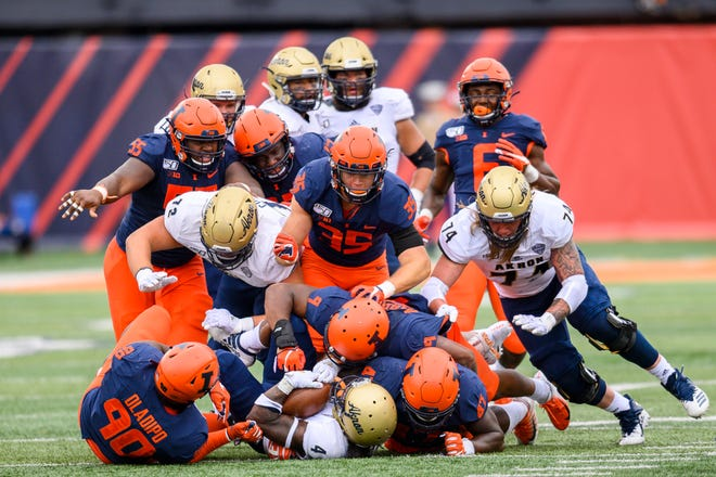 Illinois Fighting Illini wide receiver Ricky Smalling gets tackled for a loss during the second half against the Akron Zips at Memorial Stadium. Sports